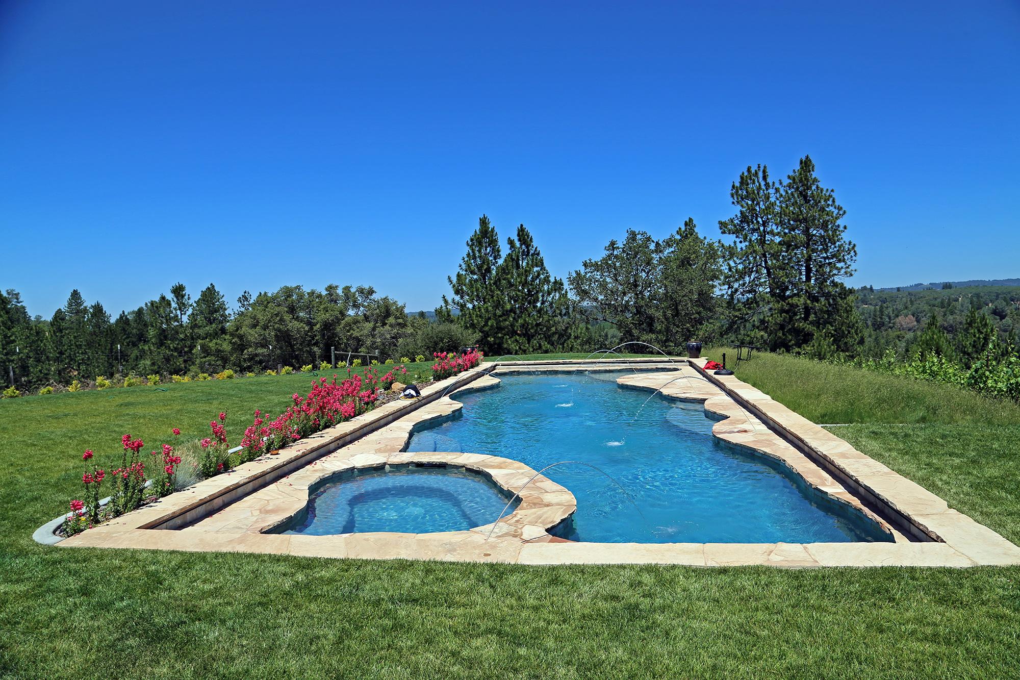 Heated swimming pool with vineyard views in the Sierra Foothills