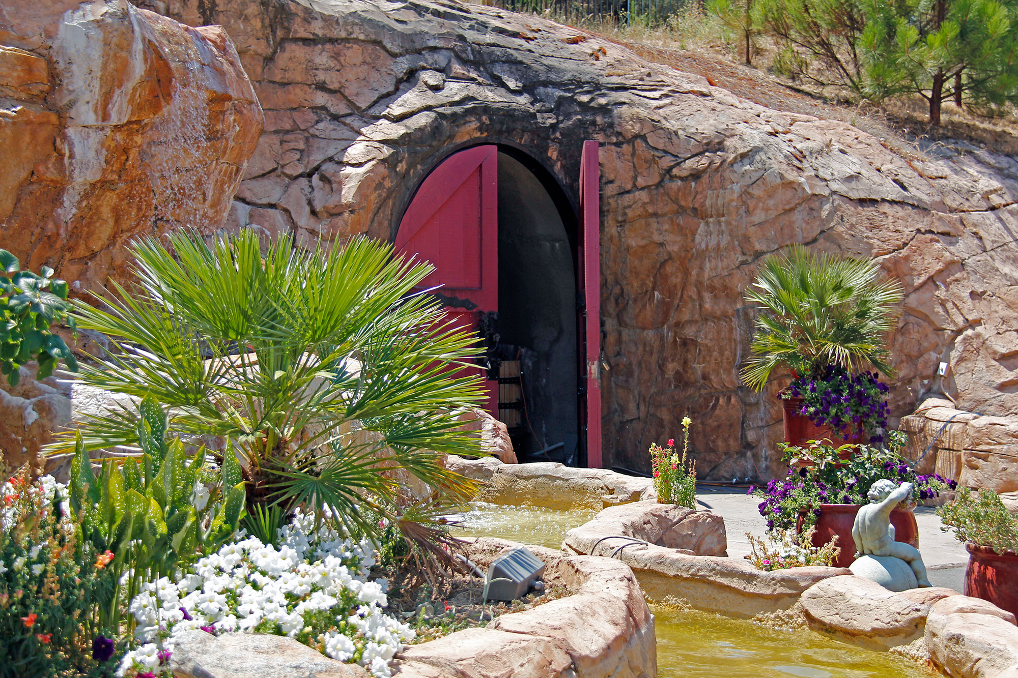 Waterfall and entrance to the epic wine cave
